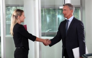 A-firm-Handshake-And-A-Dress-For-Success-Example-New-Employee-Meeting-The-Boss-For-The-First-Time