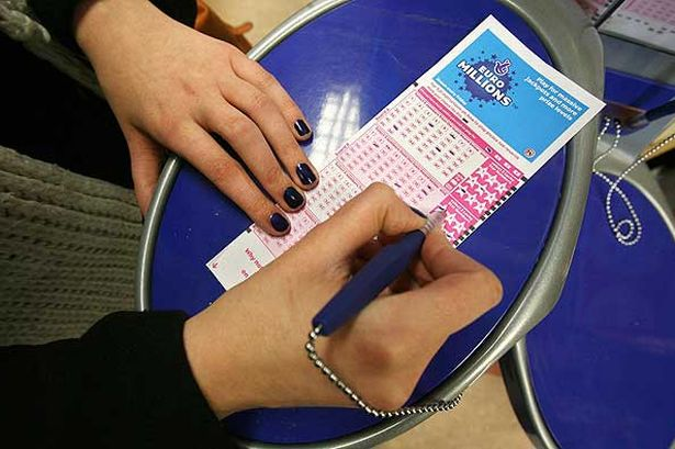 a-woman-fills-in-a-euromillions-lottery-ticket-pic-pa-153200103